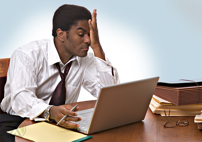 stressed-businessman-looking-at-his-laptop-screen