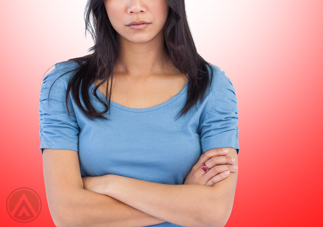 Asian-female-arms-crossed-dissatisfied