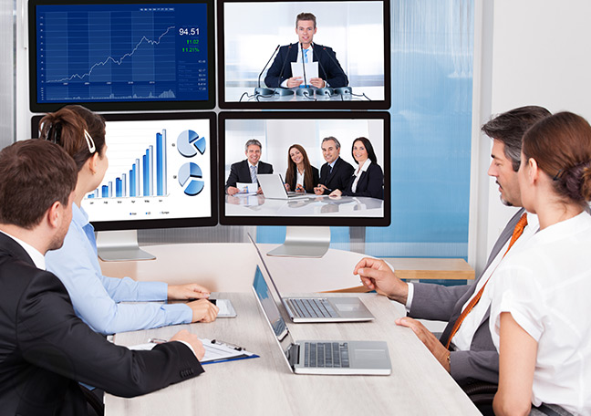 Business-people-holding-a-video-conference-on-multiple-screens