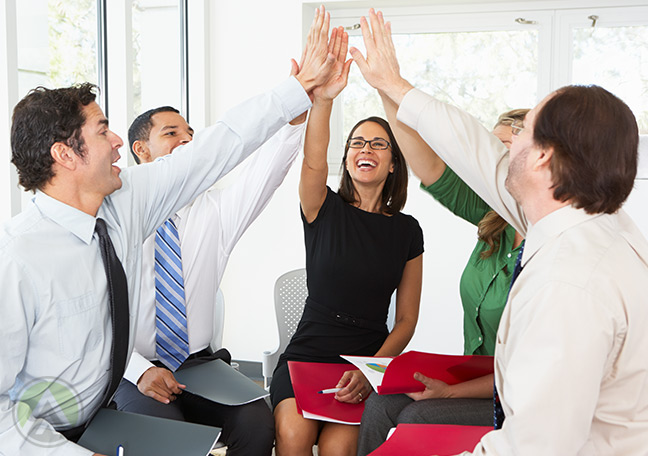 Colleagues-doing-a-group-high-five