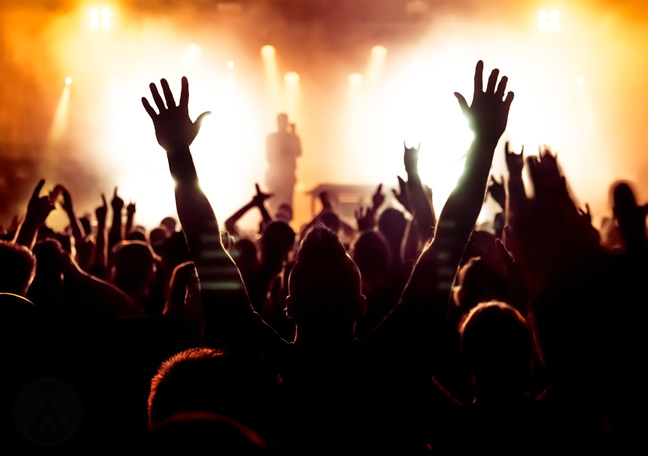 fans-raising-hands-during-concert