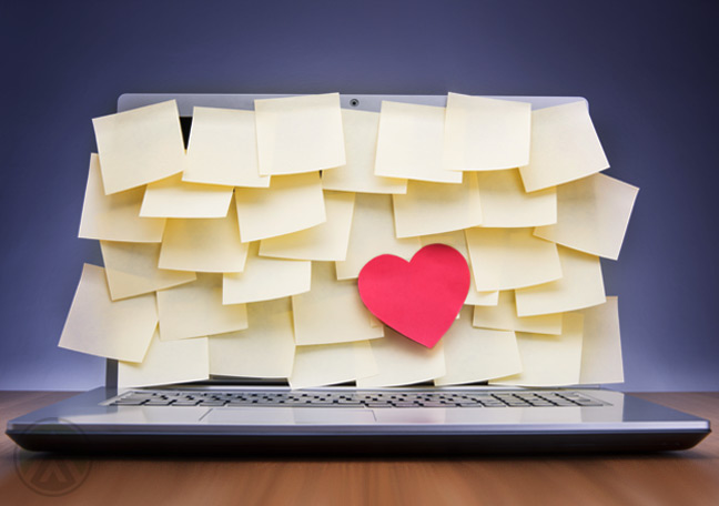 laptop-filled-with-post-it-noted-and-a-cutout-heart