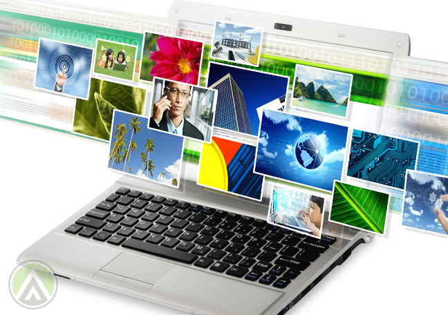 laptop-showing-mul;different-colorful-photos