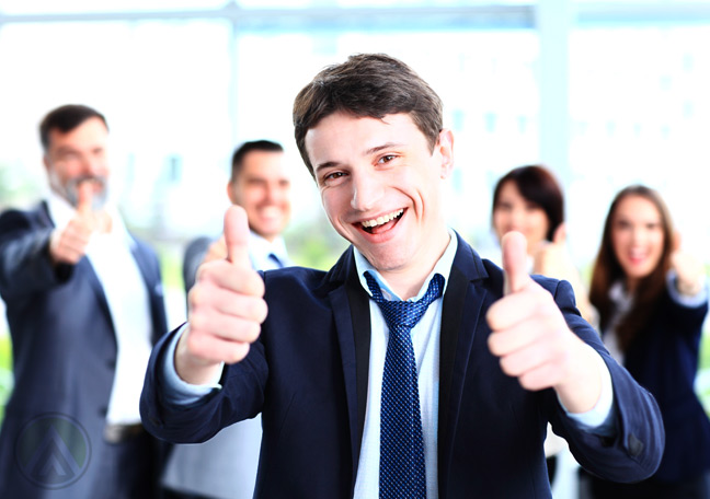 male-businessman-thumbs-up-coworkers