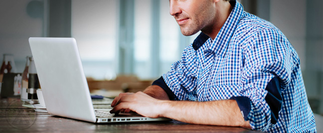 male-employee-studying-on-laptop