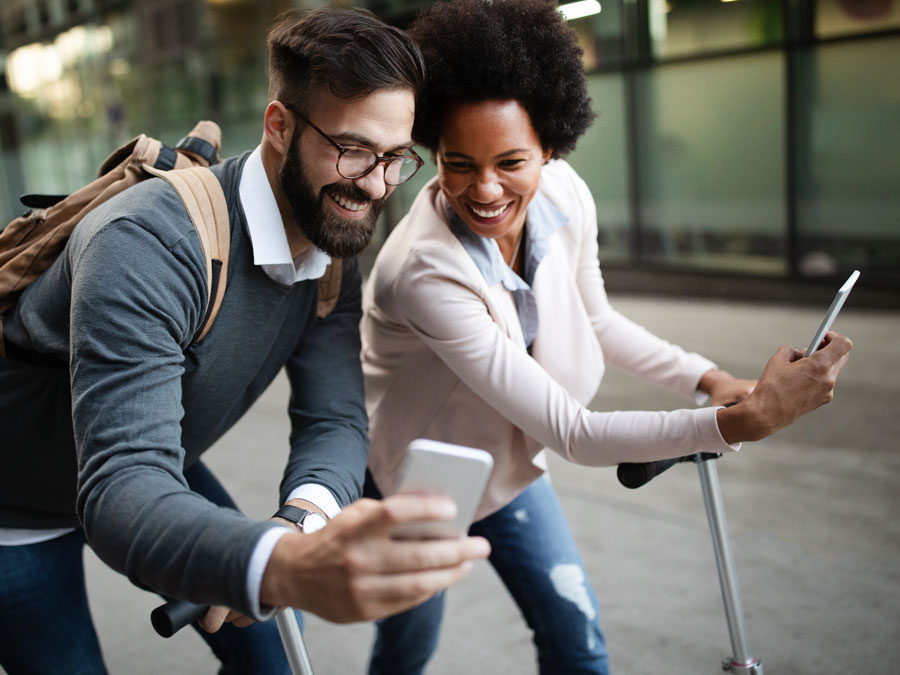 multicultural couple with online customer service agent on smartphone call
