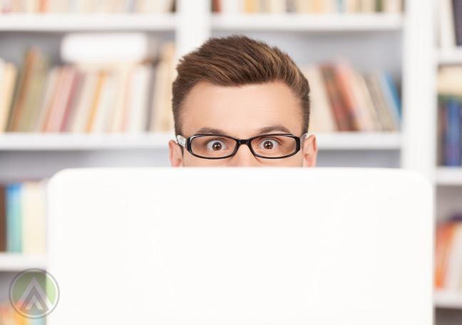 surprised-businessman-behind-laptop