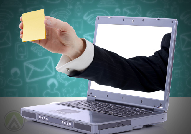 businessman-arms-moving-out-of-laptop-with-post-in-in-hand