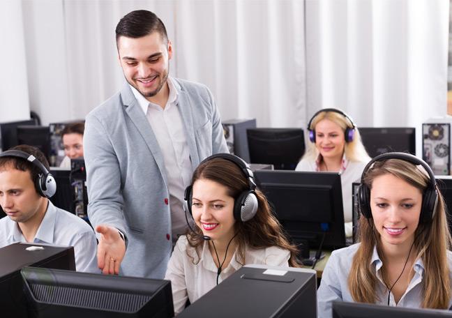 male-call-center-supervisor-assisting-customer-service-agent