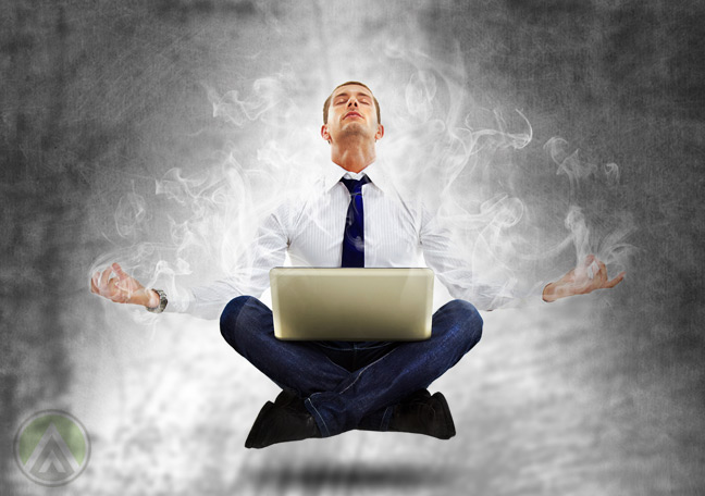 meditating-glowing-floating-businessman-with-laptop