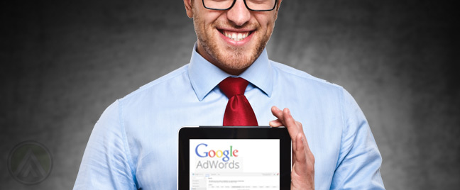 smiling-businessman-with-tablet-on-GOogle-Adwords