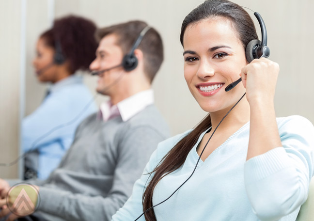 smiling-female-call-center-agent-with-customer-service-team