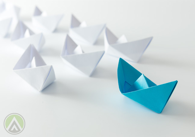 teal-paper-board-followed-by-white-paper-boats
