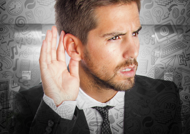 businessman listening with social media icons around him