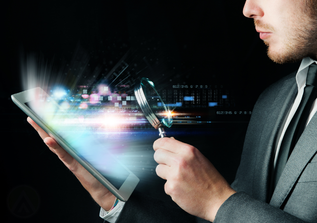 businessman-looking-at-tablet-through-magnifying-glass-in-the-dark