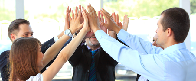 diverse-business-team-high-fiving