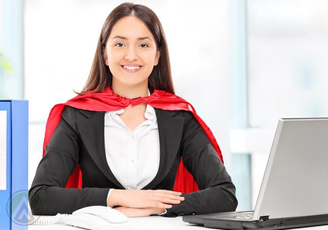 female-millennial-employee-at-office-desk-wearing-cake