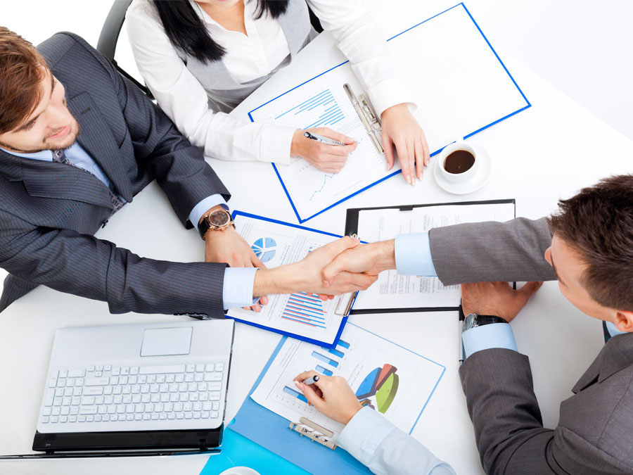 business BPO executives shaking hands agreeing on outsourcing contracts