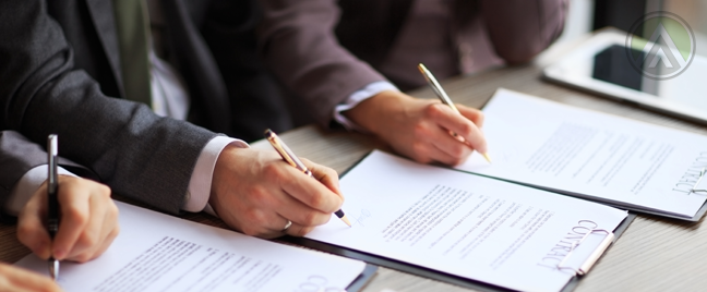 business-executives-signing-partnership-contracts