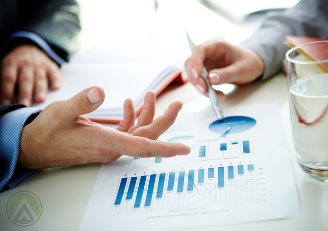 businessman-hands-discussing-charts-graphs