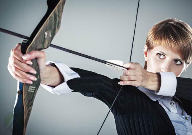 female-business-executive-aiming-a-bow-and-arrow