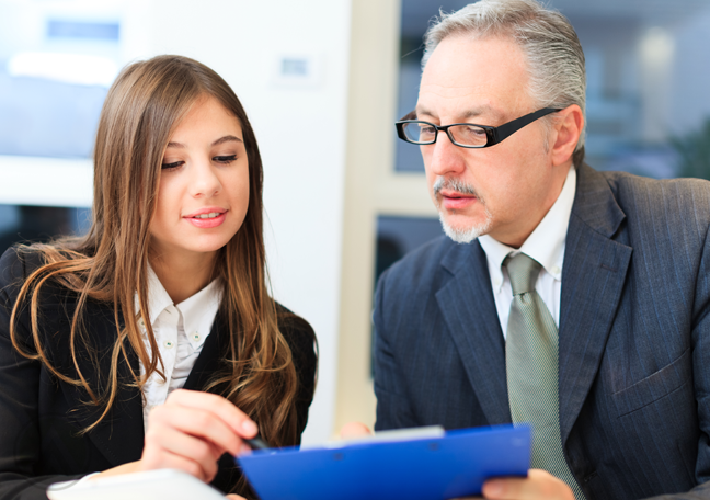 mature-businessman-discussing-report-with-female-employee