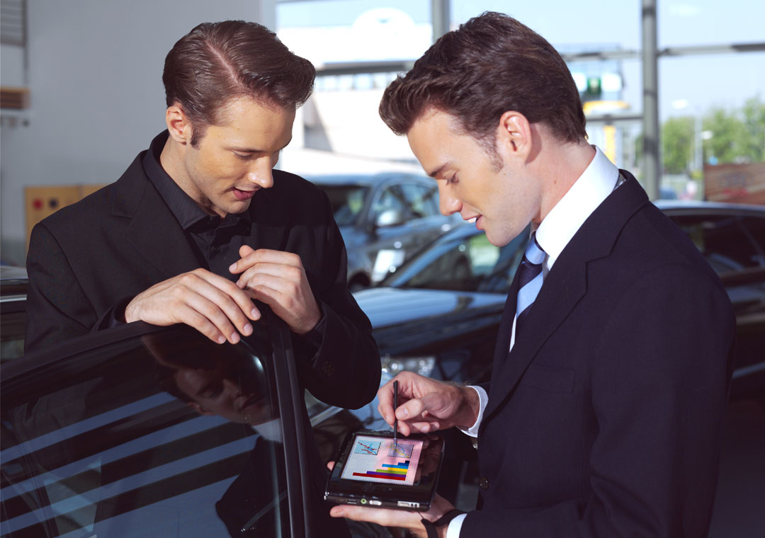 salesman showing product features on tablet