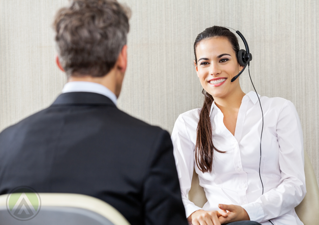 smiling-brunette-woman-on-a-mock-call-in-front-of-male-boss