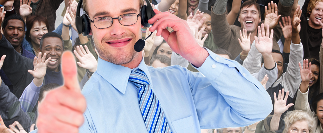 smiling-male-call-center-agent-giving-thumbs-up-with-excited-people-in-background