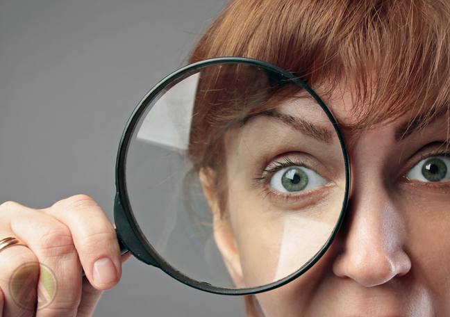 woman-looking-through-magnifying-lens