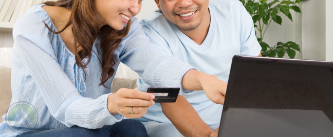 Chinese-Asian-couple-on-laptop-online-shopping