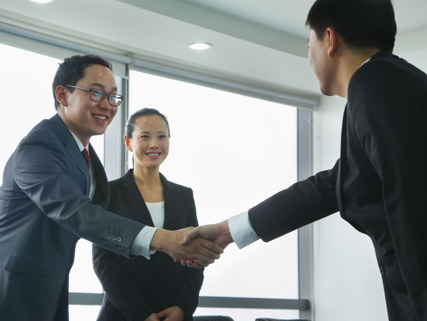Chinese ecommerce distributor shaking hands with business executive