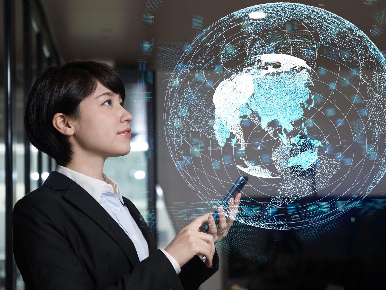 Chinese ecommerce executive on location using virtual globe