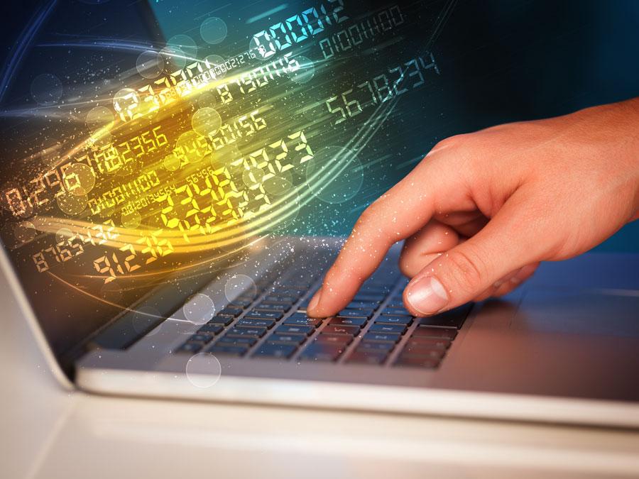 IT helpdesk hand pressing laptop keyboard