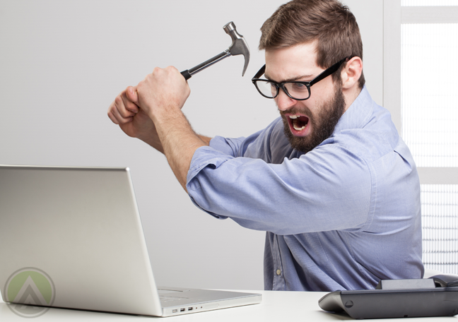 angry-employee-in-glasses-about-to-hit-laptop-with-hammer