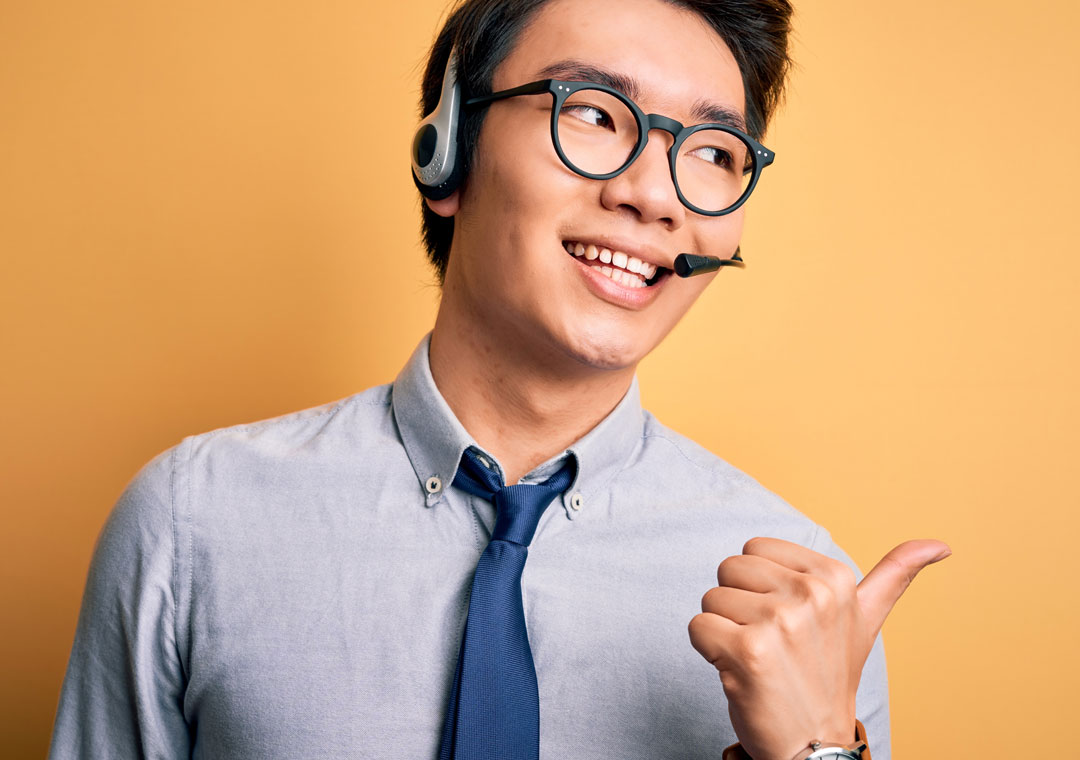 happy customer care agent giving thumbs up