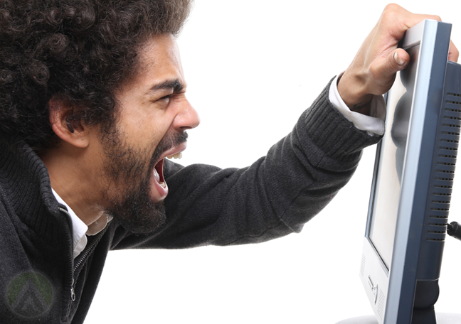 man-with-afro-shouts-at-computer-monitor