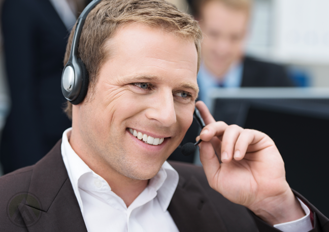 smiling-male-call-center-agent-in-a-sales-call