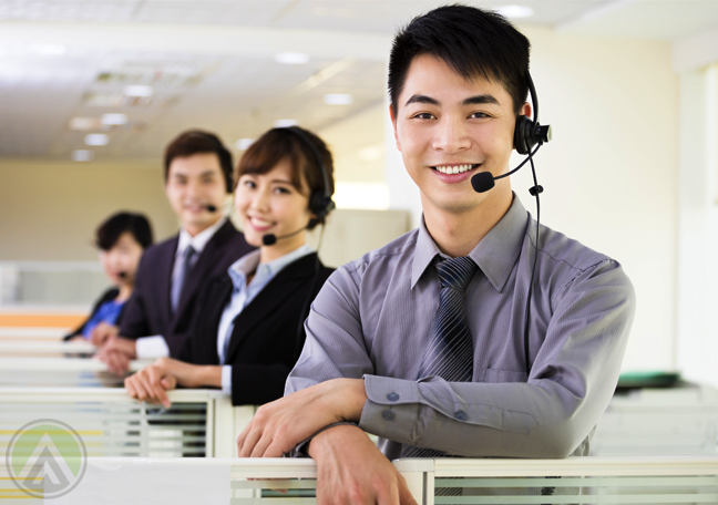 asian-filipino-call-center-agents-smiling-by-office-cubicles
