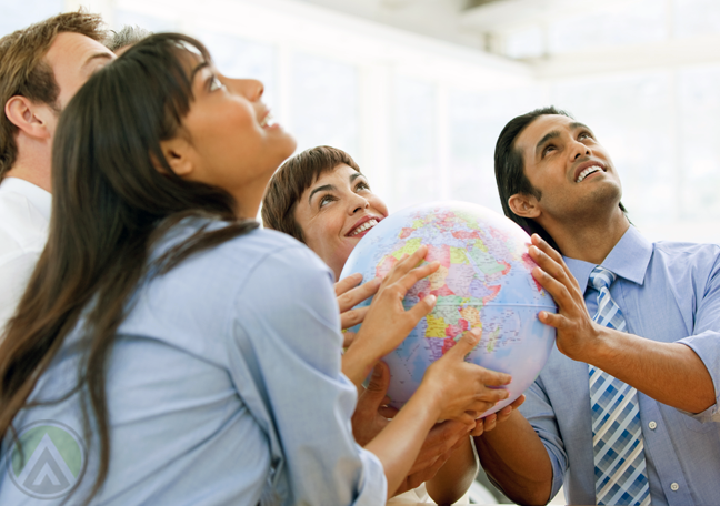 diverse-multilingual-cultural-business-team-holding-globe-looking-up