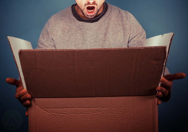 man-surprised-looking-into-big-box