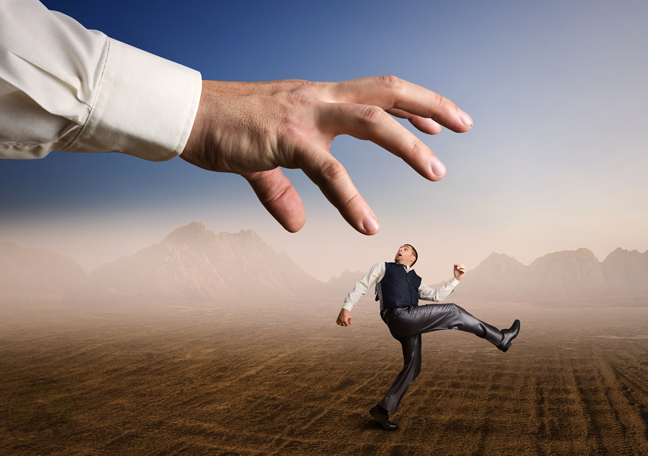 running-businessman-chased-by-giant-hand
