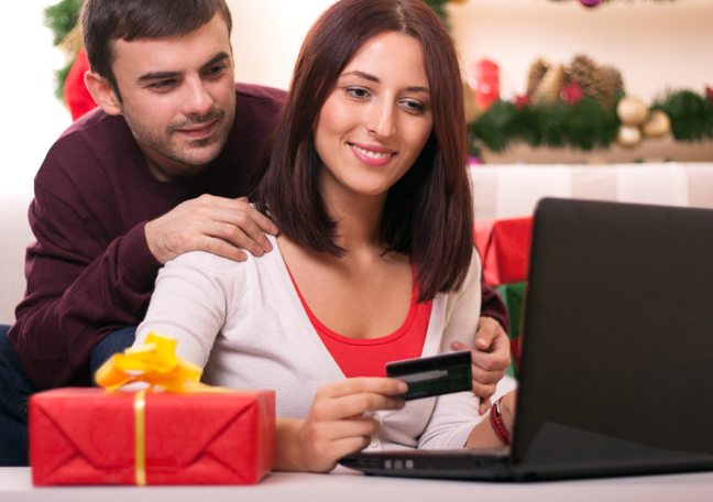 couple-by-laptop-holding-credit-card