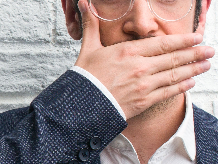 ecommerce businessman covering mouth