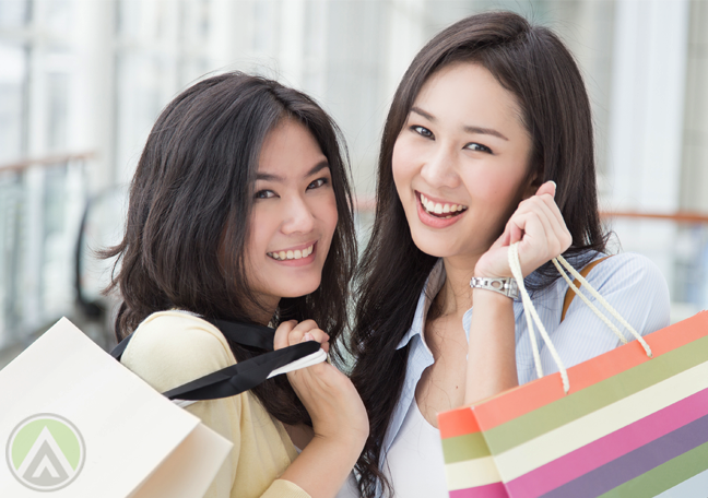 smiling-Thai-women-holding-shopping-bags