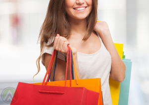 smiling-woman-with-shopping-bags