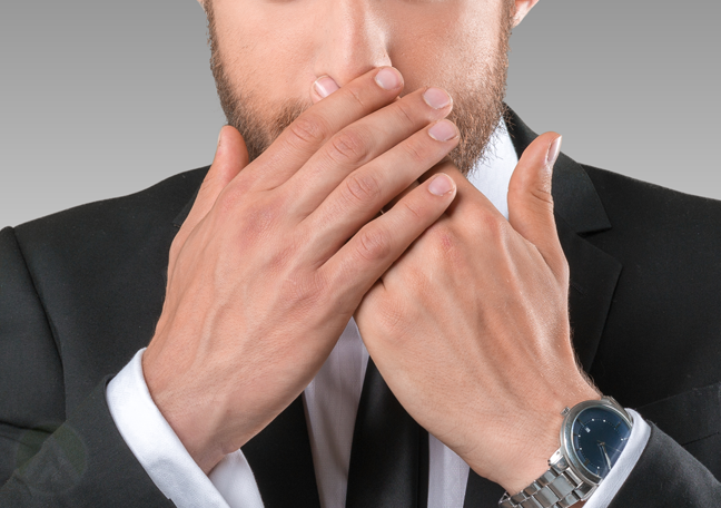 bearded-businessman-covering-mouth