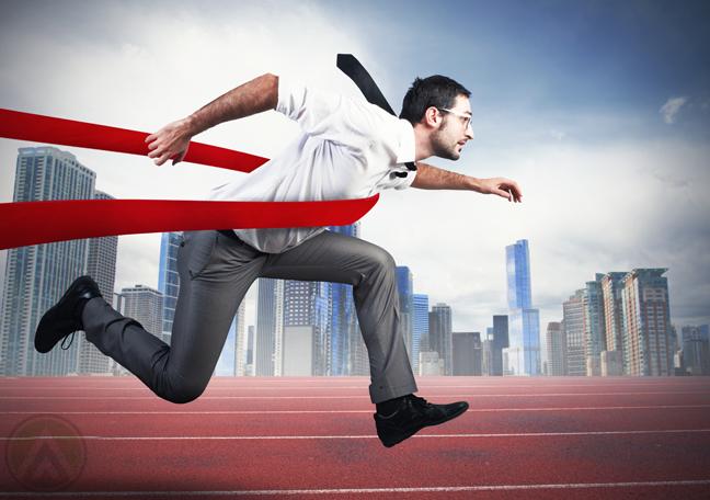 businessman-running-through-finish-line