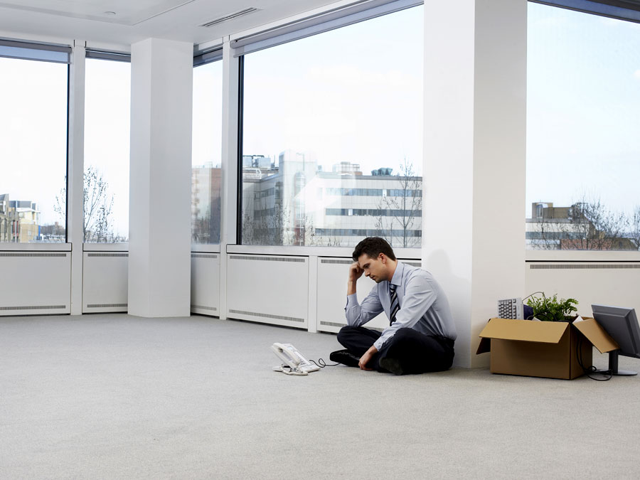company employee alone in empty office