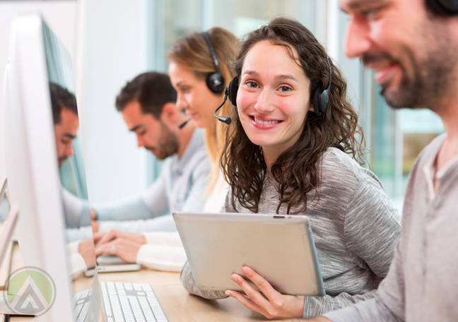 customer-service-agent-holding-laptop-tablet-with-smiling-call-center-team